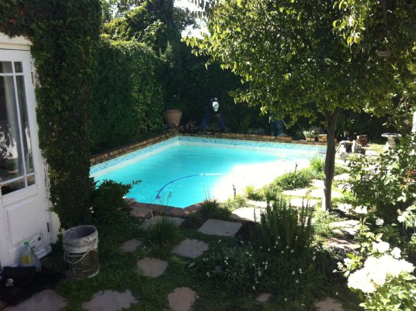 An outdated and asymmetrical pool transformed into a pool with clean lines and a contemporary style.