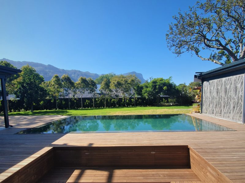 The brief here was for the pool to blend in seamlessly with the huge decked patio.