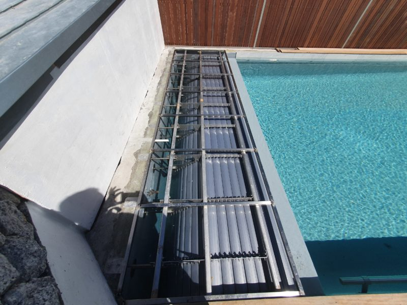 Automated pool cover with silver grey solar slats