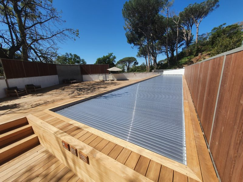 Silver slatted solar cover gives peace of mind for water saving, heat retention and safety.
