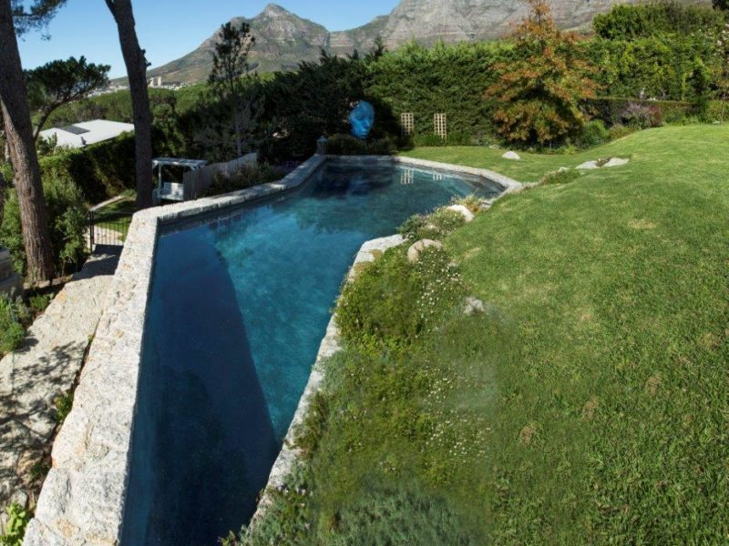 Natural granite was used for the coping and cladding, making this pool blend into the landscaped garden with ease.