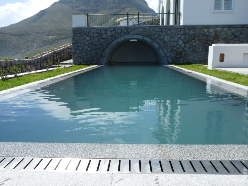 The cave adds a bit of James Bond, and accommodates the automated pool cover